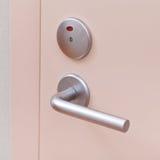 Door with metallic handle Stock Images