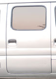 The door of a microbus. The door of grey silver microbus stock photos