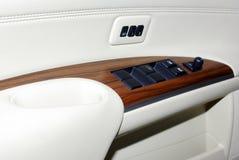 Car door interior inside panel handle vehicle modern transportation transport automobile design leather lock luxury control wood stock photos