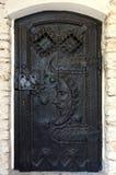 Door moon carve. Black door with a moon caved on it Stock Images