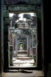 Door and more. Green rubble walk with sun coming through the chamber roof angkor wat Stock Image