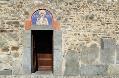 Door and mosaic lunette on an italian church Stock Images