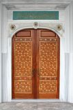 The door of the mosque. Wooden door with a pattern in the mosque Stock Images
