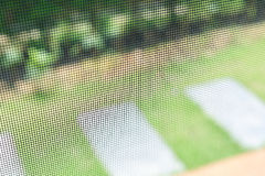 Door mosquito wire screen steel net protection. Door mosquito wire screen black steel net protection from small insect bug Royalty Free Stock Image