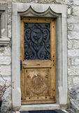 Door with the municipal coat of arms, Gules, a Crane rising Argent. Royalty Free Stock Images