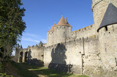 Door of Narbonne. Lateral sight of the Door of Narbonne and the walls of the Cite of Carcassonne royalty free stock photography