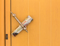 Door with newspaper Royalty Free Stock Images