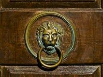 Door nob. Old metal door nob on the wooden door. Summer sunny day Royalty Free Stock Image