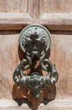 Door NOB. Bras doorknocker on wood door Royalty Free Stock Images