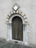 Door 1. Normal wooden door is surrounded by an ornate stone archway Royalty Free Stock Photos