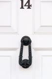 Door number 14 and door knocker Royalty Free Stock Photos