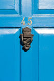 Door number 45 reflective sign with door knocker Stock Image