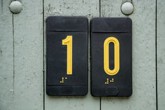 Door number sign plate with braille Royalty Free Stock Photography