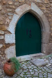 Door in Obidos, Portugal. Obidos - a medieval city, an open air museum. The city walls encircling the city dense ring, churches, narrow streets with colorful Stock Photography