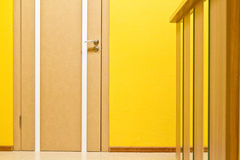 Door in an office, yellow wall and a reception Royalty Free Stock Images