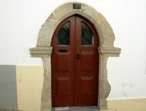 Door in ogive. In a typical street of the city of Évora, which is considered património of the humanity for UNESCO Stock Images