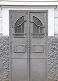 Door  old architecture home design enter details. Door metall old designer work Stock Images
