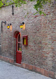 Door in old brick wall Stock Photo