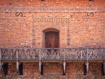 Door in old brick wall Stock Photo