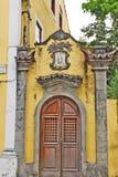 A door of an old building. Olinda, Recife, Pernambuco, Brazil, 2009. Beautiful colourful houses in Olinda. A door of an old building stock photo