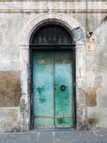 Door of an old building with rusty and peeling paint Royalty Free Stock Photos