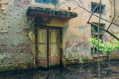 Door of old flooded abandoned house.  royalty free stock images