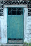 Door. The old green door decorated with curved steel Stock Images