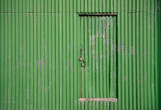 Door on a old green shed Stock Photos