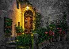 Door in an old house decorated with flower at night Stock Photo
