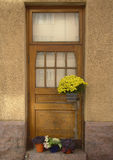 Door of an old house and flowers stock photos