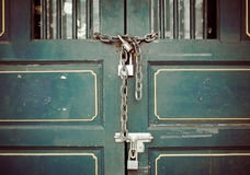 Door of an old house locked by a chain Royalty Free Stock Photo
