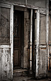 Door of the old house.photos in the style of horror. The wide-open doors of the ancient ruined house Stock Photography