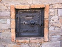 Door from an old oven outside on the facade royalty free stock photo