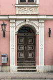Door of an old residential building in the classicism style. Riga, Latvia. The door of an old residential building from 1780 in the style of classicism at the Stock Photo