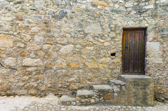 Door in old stone house. Detail of door in old stone house in a Extremadura rural village. Copy space Royalty Free Stock Photography