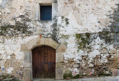 Door in old stone house. Detail of door in old stone house in a Extremadura rural village. Copy space Stock Photos