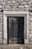 Door. Old wooden door in an old stone wall Stock Image