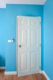 The Door is open in blue room Stock Photo