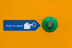 Door open push button in green Royalty Free Stock Image