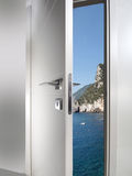 Door open to the coast. White door open to the sea coast sunset stock photography