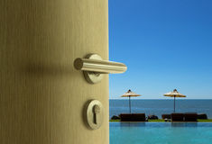 The door open to sea view in blue sky Stock Image