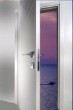 Door open to the sea. White door open to the sea stock image