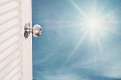 Door opening with blue sky and shiny sunshine, dreamy concepts Stock Photography