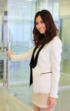 Door opening business woman coming in office. Door opening business asian woman coming in office royalty free stock image