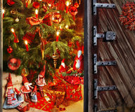Door opening into a room with christmas tree and gift Royalty Free Stock Photo