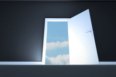 Door opening in room to show sky Royalty Free Stock Images