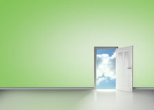 Door opening to reveal blue cloudy sky Royalty Free Stock Images