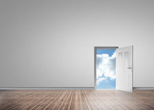 Door opening to reveal sunny blue sky. In a grey room with floorboards Stock Photography