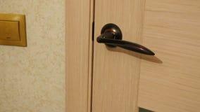 The door opens a door handle. The door opens . Turn the door knob stock video footage