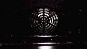 White fan is spinning in the oven stock video footage